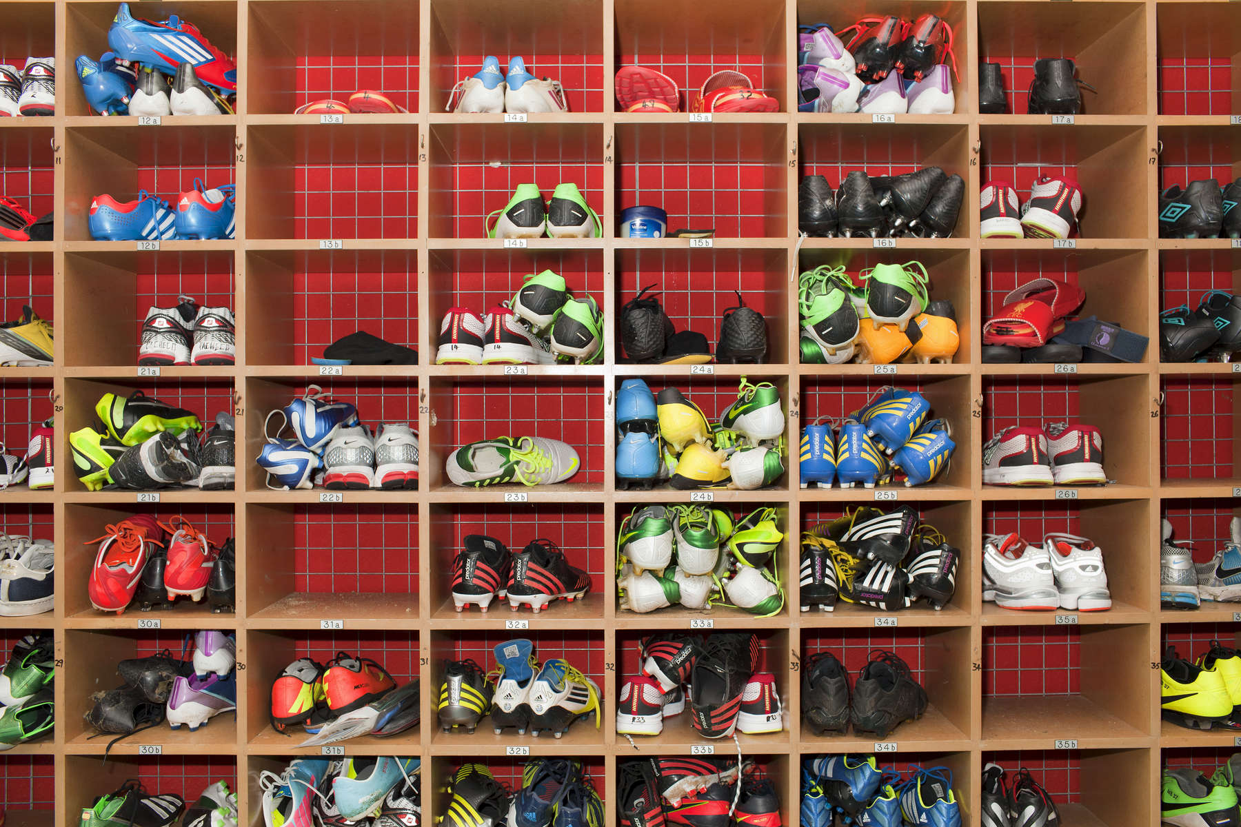 Liverpool FC players boots at Melwood.Melwood is the Liverpool FC training ground, located in the West Derby area of Liverpool. It is seperate from the Liverpool Academy, which is based in Kirkby.Melwood was redeveloped in the early 2000′s with large input from then-manager Gerard Houllier and now features some of the best facilities in Europe. It has been the club's training ground since the fifties and was previously transformed into a top class facility by Bill Shankly.Facilities include sythetic pitches, rehabilitation rooms, press and meeting rooms, gymnasium, swimming pool, restaurant and recreational facilities.