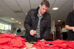 Liverpool legend Jamie Carragher signs shirts in the canteen at Melwood.Melwood is the Liverpool FC training ground, located in the West Derby area of Liverpool. It is seperate from the Liverpool Academy, which is based in Kirkby.Melwood was redeveloped in the early 2000′s with large input from then-manager Gerard Houllier and now features some of the best facilities in Europe. It has been the club's training ground since the fifties and was previously transformed into a top class facility by Bill Shankly.Facilities include sythetic pitches, rehabilitation rooms, press and meeting rooms, gymnasium, swimming pool, restaurant and recreational facilities.