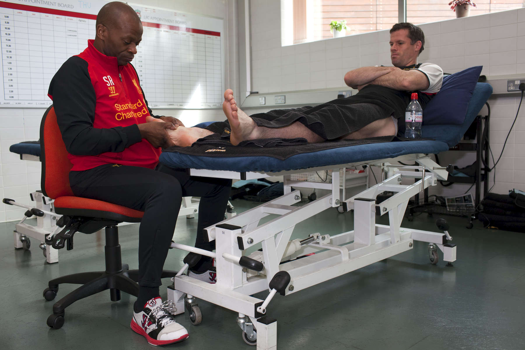Liverpool FC defender Jamie Carragher reveives treatment to hid right foot at Melwood.Melwood is the Liverpool FC training ground, located in the West Derby area of Liverpool. It is seperate from the Liverpool Academy, which is based in Kirkby.Melwood was redeveloped in the early 2000′s with large input from then-manager Gerard Houllier and now features some of the best facilities in Europe. It has been the club's training ground since the fifties and was previously transformed into a top class facility by Bill Shankly.Facilities include sythetic pitches, rehabilitation rooms, press and meeting rooms, gymnasium, swimming pool, restaurant and recreational facilities.