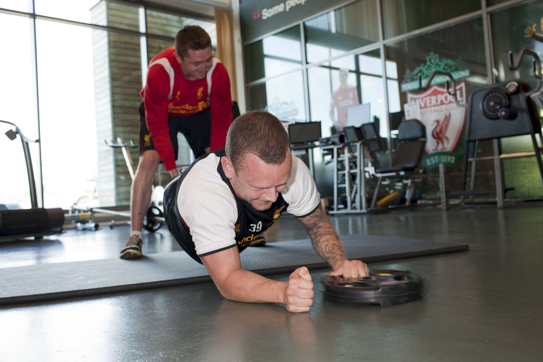 Liverpool FC defensive midfielder Jay Spearing receives a work out in the gym at Melwood.Melwood is the Liverpool FC training ground, located in the West Derby area of Liverpool. It is seperate from the Liverpool Academy, which is based in Kirkby.Melwood was redeveloped in the early 2000′s with large input from then-manager Gerard Houllier and now features some of the best facilities in Europe. It has been the club's training ground since the fifties and was previously transformed into a top class facility by Bill Shankly.Facilities include sythetic pitches, rehabilitation rooms, press and meeting rooms, gymnasium, swimming pool, restaurant and recreational facilities.