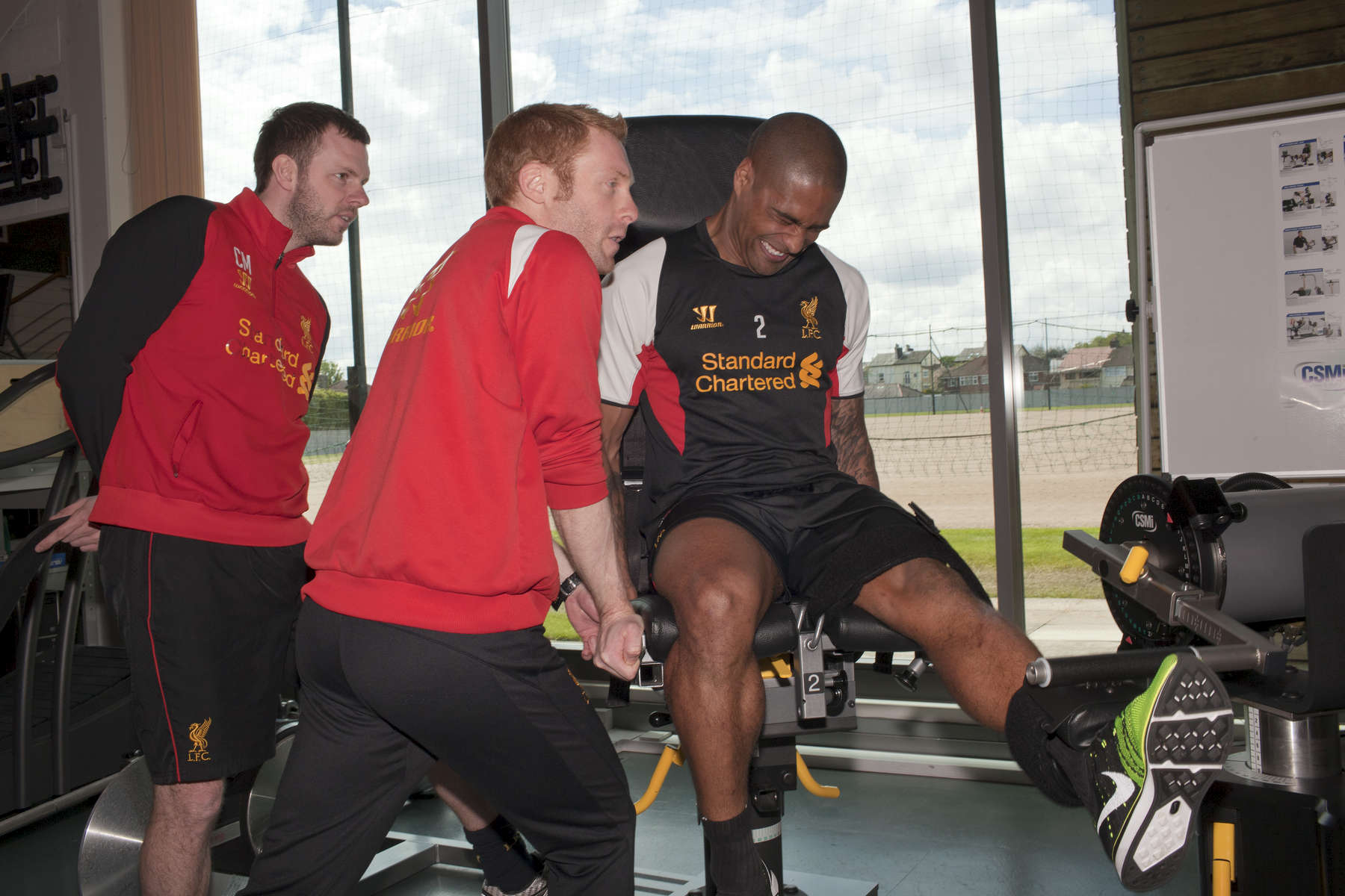 England and Liverpool FC right back Glen Johnson in the gym at Melwood.Melwood is the Liverpool FC training ground, located in the West Derby area of Liverpool. It is seperate from the Liverpool Academy, which is based in Kirkby.Melwood was redeveloped in the early 2000′s with large input from then-manager Gerard Houllier and now features some of the best facilities in Europe. It has been the club's training ground since the fifties and was previously transformed into a top class facility by Bill Shankly.Facilities include sythetic pitches, rehabilitation rooms, press and meeting rooms, gymnasium, swimming pool, restaurant and recreational facilities.