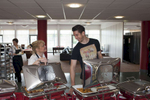 Liverpool FC player Brad Jones chats with canteen staff on training day at Melwood.Melwood is the Liverpool FC training ground, located in the West Derby area of Liverpool. It is seperate from the Liverpool Academy, which is based in Kirkby.Melwood was redeveloped in the early 2000′s with large input from then-manager Gerard Houllier and now features some of the best facilities in Europe. It has been the club's training ground since the fifties and was previously transformed into a top class facility by Bill Shankly.Facilities include sythetic pitches, rehabilitation rooms, press and meeting rooms, gymnasium, swimming pool, restaurant and recreational facilities.