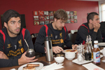 Liverpool FC striker Luis Suarez, Sebastian Coates (and Stuart Downing at breakfast before training at Melwood.Melwood is the Liverpool FC training ground, located in the West Derby area of Liverpool. It is seperate from the Liverpool Academy, which is based in Kirkby.Melwood was redeveloped in the early 2000′s with large input from then-manager Gerard Houllier and now features some of the best facilities in Europe. It has been the club's training ground since the fifties and was previously transformed into a top class facility by Bill Shankly.Facilities include sythetic pitches, rehabilitation rooms, press and meeting rooms, gymnasium, swimming pool, restaurant and recreational facilities.