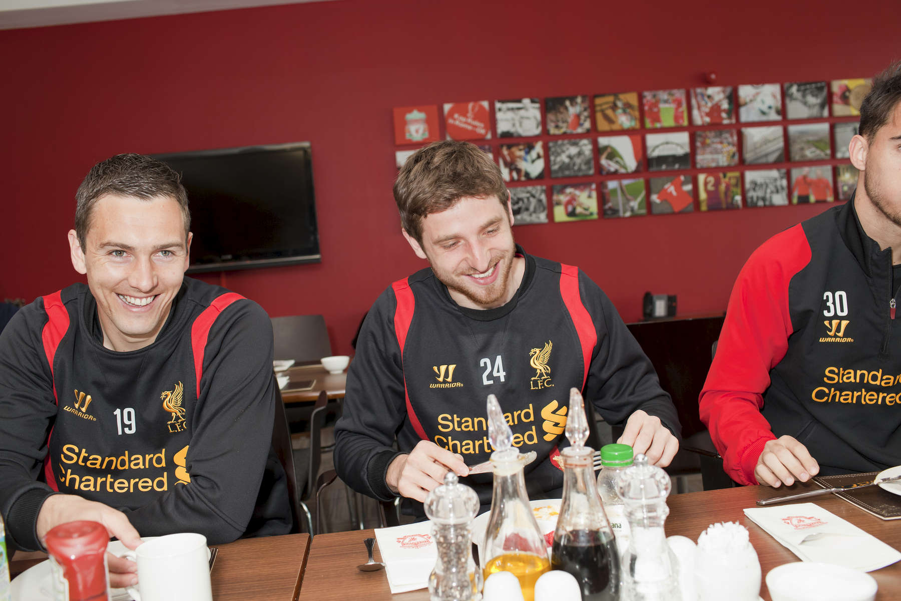 Liverpool FC players Stuart Downing (left) and Joe Allen (centre) share a joke over breakfast in the canteen at Melwood.Melwood is the Liverpool FC training ground, located in the West Derby area of Liverpool. It is seperate from the Liverpool Academy, which is based in Kirkby.Melwood was redeveloped in the early 2000′s with large input from then-manager Gerard Houllier and now features some of the best facilities in Europe. It has been the club's training ground since the fifties and was previously transformed into a top class facility by Bill Shankly.Facilities include sythetic pitches, rehabilitation rooms, press and meeting rooms, gymnasium, swimming pool, restaurant and recreational facilities.