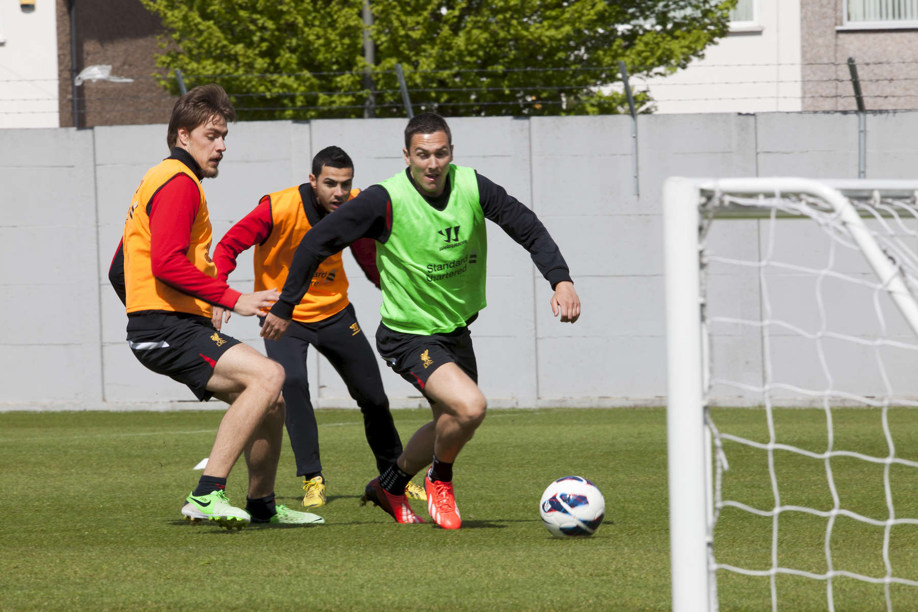 Sebastian Coates, (left) and Stuart Dwoning (right) in a training game at Melwood. Melwood is the Liverpool FC training ground, located in the West Derby area of Liverpool. It is seperate from the Liverpool Academy, which is based in Kirkby.Melwood was redeveloped in the early 2000′s with large input from then-manager Gerard Houllier and now features some of the best facilities in Europe. It has been the club's training ground since the fifties and was previously transformed into a top class facility by Bill Shankly.Facilities include sythetic pitches, rehabilitation rooms, press and meeting rooms, gymnasium, swimming pool, restaurant and recreational facilities.