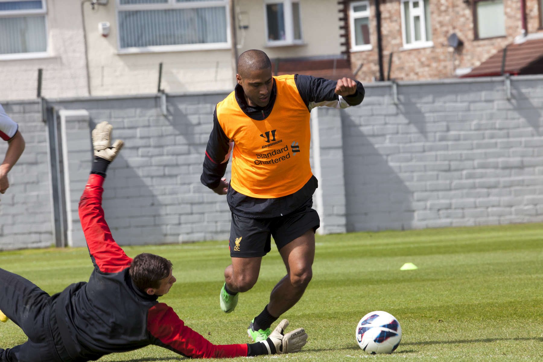 England and Liverpool FC right back Glen Johnson rounds the keeper during a training session at Melwood.Melwood is the Liverpool FC training ground, located in the West Derby area of Liverpool. It is seperate from the Liverpool Academy, which is based in Kirkby.Melwood was redeveloped in the early 2000′s with large input from then-manager Gerard Houllier and now features some of the best facilities in Europe. It has been the club's training ground since the fifties and was previously transformed into a top class facility by Bill Shankly.Facilities include sythetic pitches, rehabilitation rooms, press and meeting rooms, gymnasium, swimming pool, restaurant and recreational facilities.