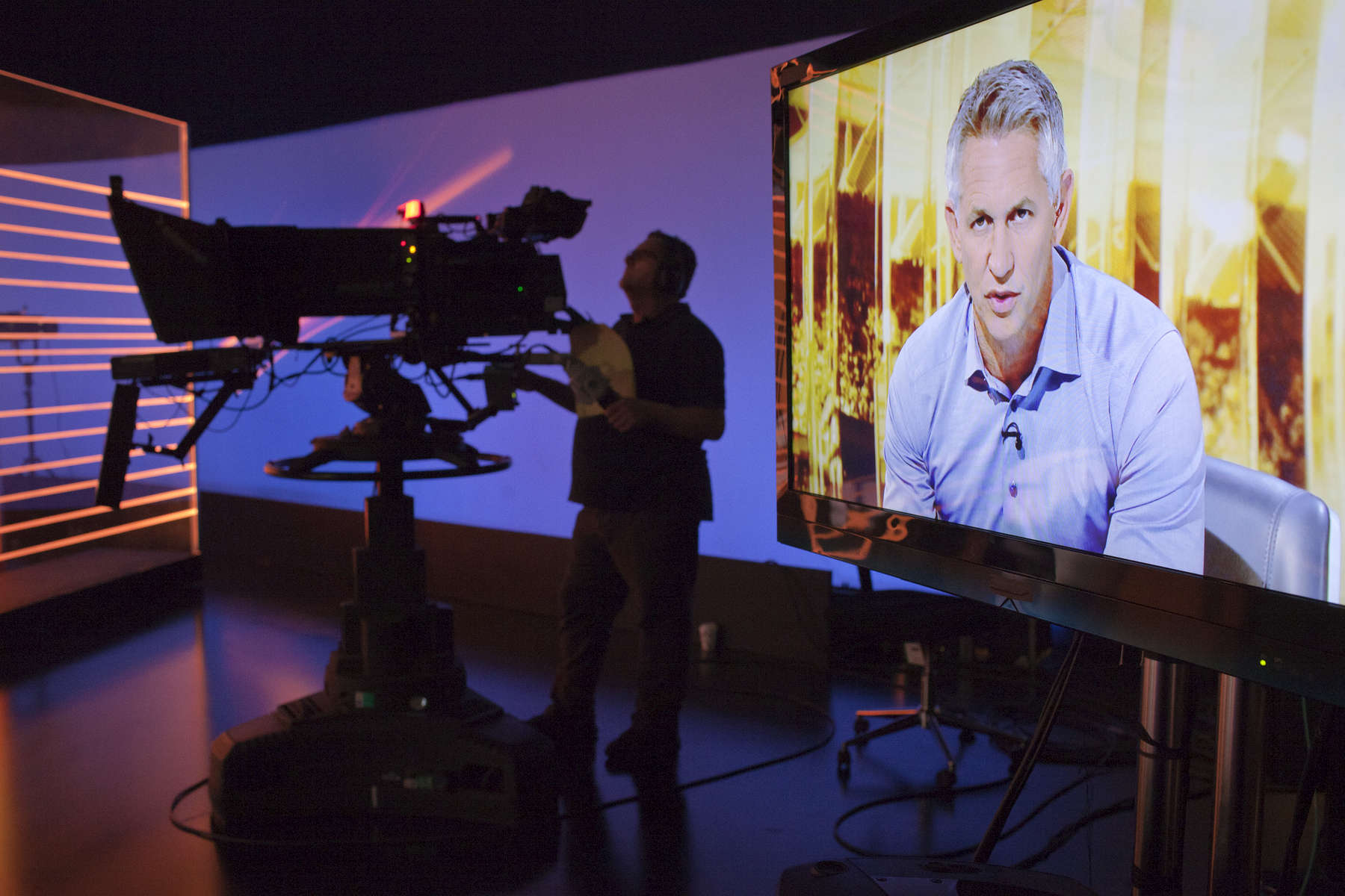 MOTD presenter Gary Lineker rehearses on set.Match of the Day (often abbreviated as MOTD or MotD) is the BBC\'s main football television programme. Typically, it is shown on BBC One on Saturday evenings during the English football season, showing highlights of the day\'s matches in English football\'s top division, the Premier League. It is one of the BBC\'s longest-running shows, having been on air since 22 August 1964, though it has not always been aired regularly. The programme is broadcast from MediaCityUK in Salford Quays on the banks of the Manchester Ship Canal in Greater Manchester.Since 1999 MOTD has been presented by the former England captain Gary Lineker. Lineker is usually joined by two pundits to analyse and review the day\'s action. The former Newcastle United captain Alan Shearer is the lead pundit