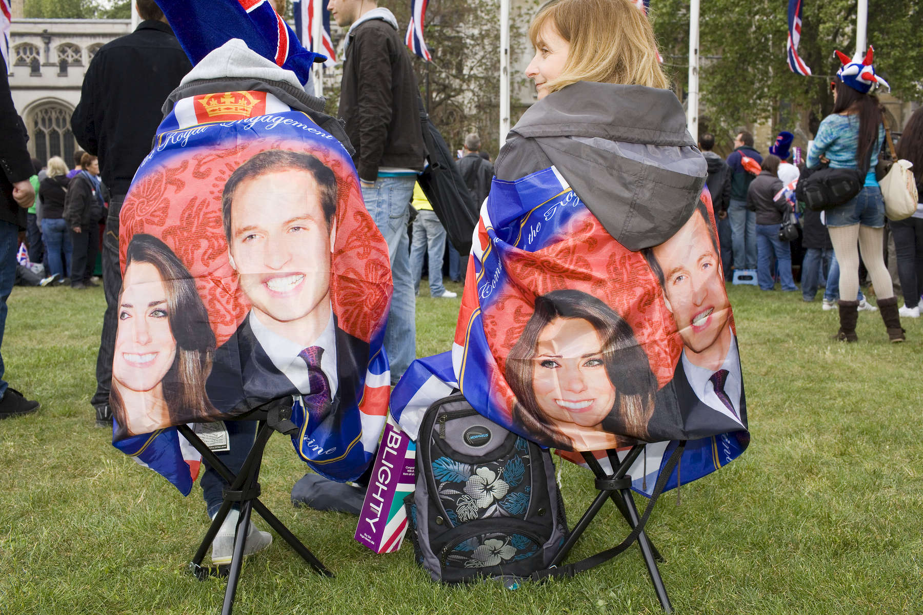 Two royal supporters sat in Parliament Square facing Westminster Abbey.