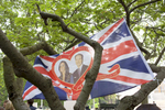 A Union Flag with a heart framed portrait of Prince William and Catherine Middleton hung in a tree along the route for the royal wedding.