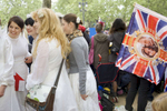 Women dressed as brides wait on the Mall in central London for the Royal Wedding between Prince William and Kate Middleton to begin.
