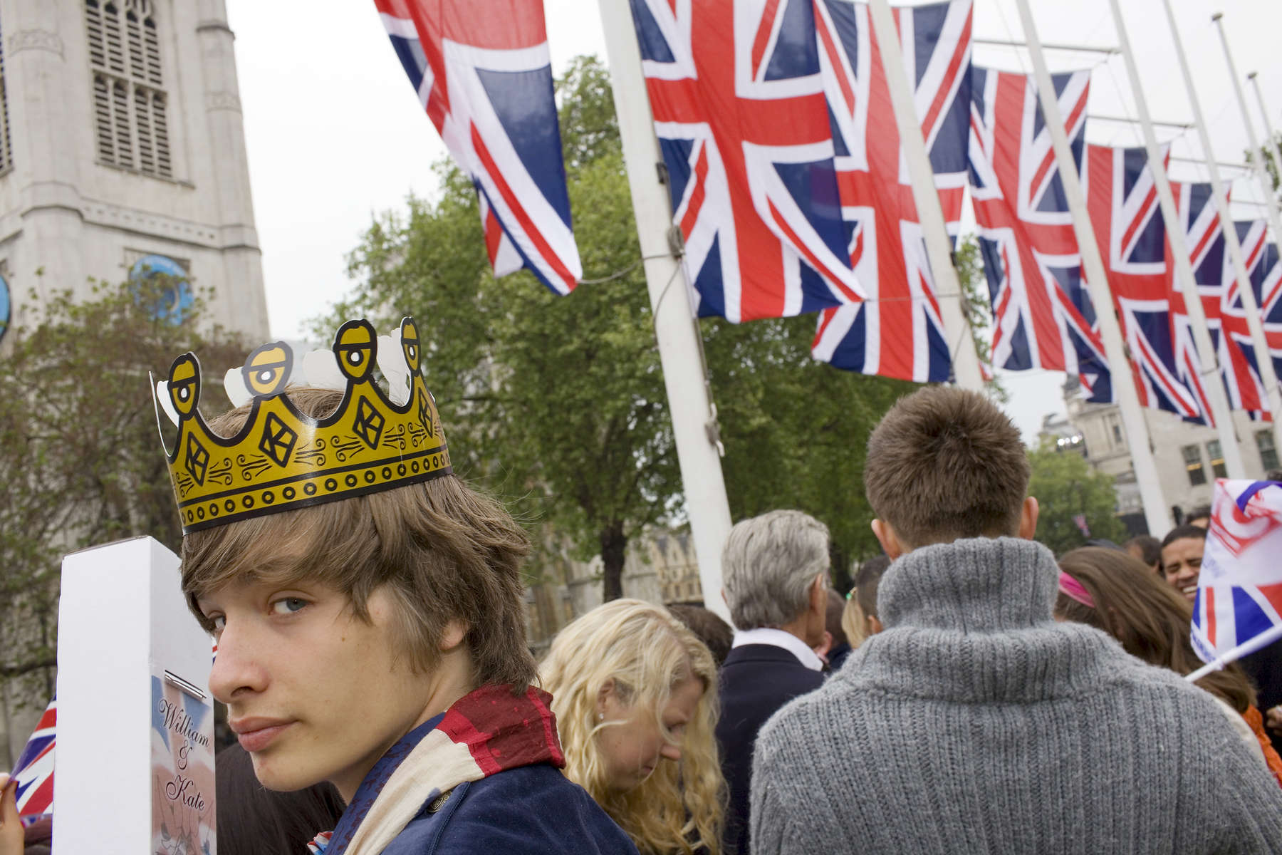 A member of the Higgins family wearing a crown watches the Royal Wedding from Parliament Square in Central London, UK.