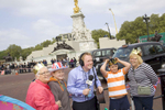 A BBC radio reporter poses for a photograph with Pam Bing 61, George Brown 13, Harry Brown 9 and Sarah Brown 40. The family are camping outside Buckingham Palace for the Royal Wedding between Prince Harry and Kate Middleton.