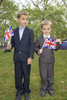 Brothers 8-year old Harry (left) and Rory Arthur, 5, dressed in suits and waving union flags wait for the royal wedding to begin between Prince William and Kate Middleton.