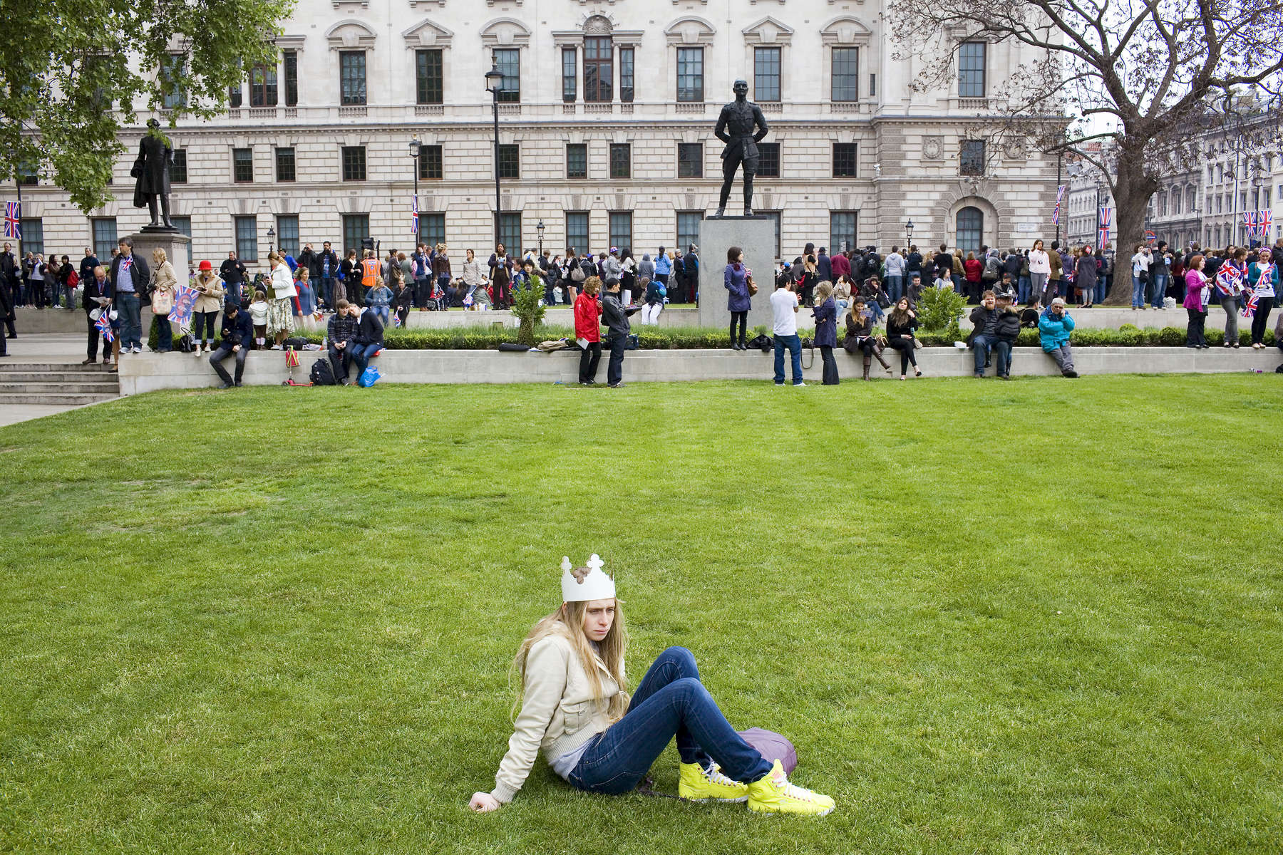 21-year old Rhyll de Teglia has a moment to herself sat in Parliament Square before the wedding of Prince William and Kate Middleton.