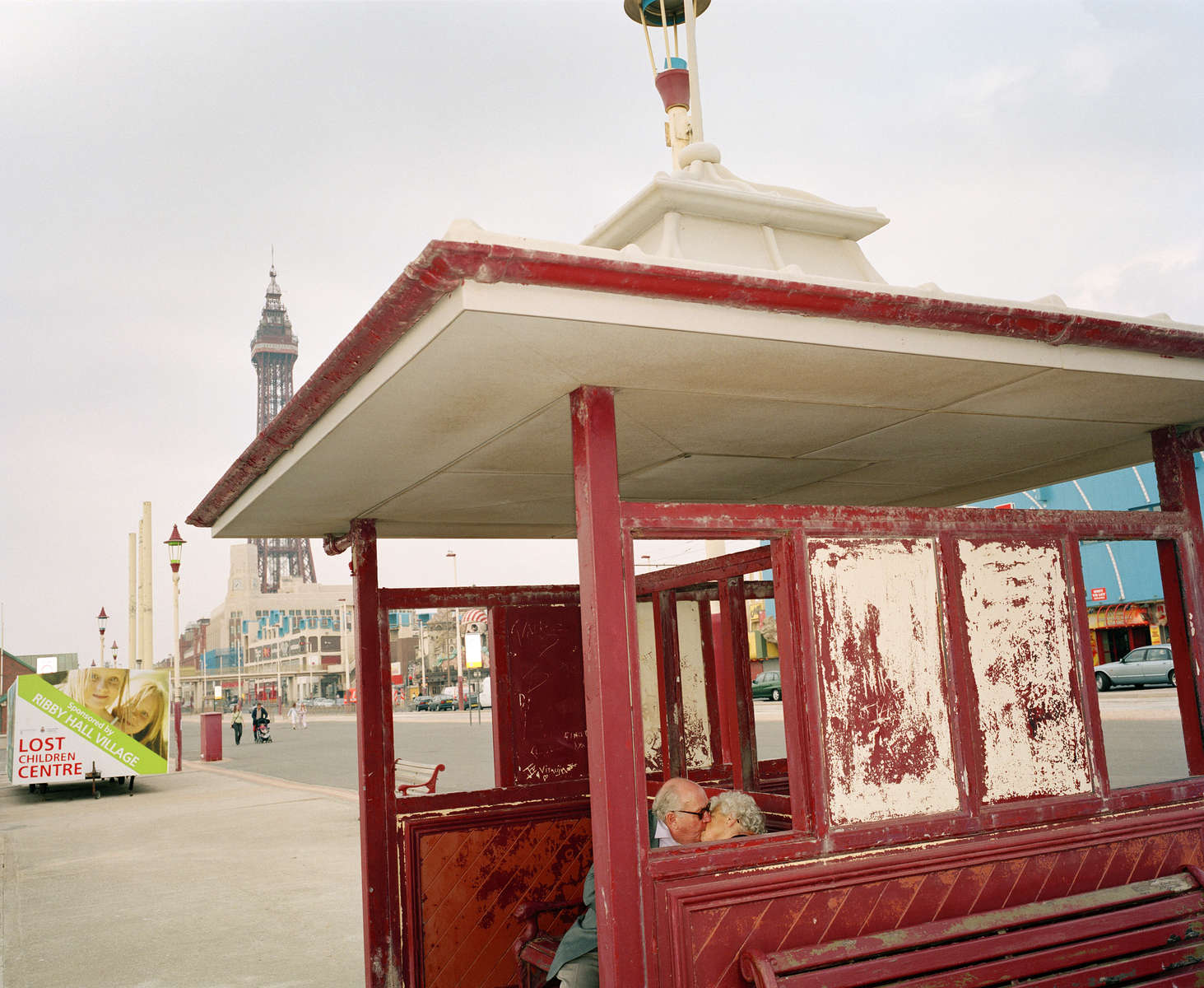 An elderly couple kiss in a weather shelter on Blackpool promenade. The town has for a long time been a destination for those in or looking for love.