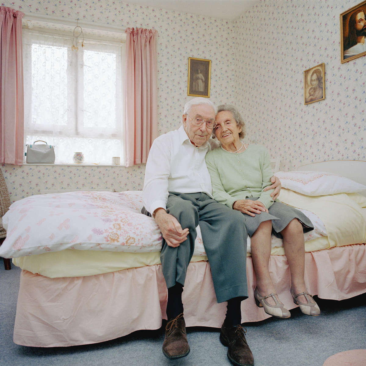 Janet 95 and Robin 85 in Janet's bedroom at Reardon Court, a social services run home for the elderly in North London. Janet has been a widow for over 30 years and Robin has lived alone since 1947. They say falling in love has been an unexpected gift.