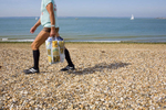 A man takes an early morning stroll along Portsmouth's pebble beach. Portsmouth is a city located in the county of Hampshire on the southern coast of England, and is the UK's only island city. It is commonly nicknamed Pompey.