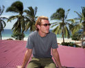 Gavin Rossdale by the beach in in the coastal town of Bagamoyo, Tanzania.Gavin McGregor Rossdale, born 30 October 1965, is an English musician and actor, known as the lead singer and rhythm guitarist of the rock band Bush. He helped form Bush in 1992, on its separation in 2002, he became the lead singer and guitarist for Institute, and later began a solo career. In 2013 Rossdale received the British Academy's Ivor Novello Award for International Achievement. In 2017, Rossdale became a coach on ITV's The Voice UK.