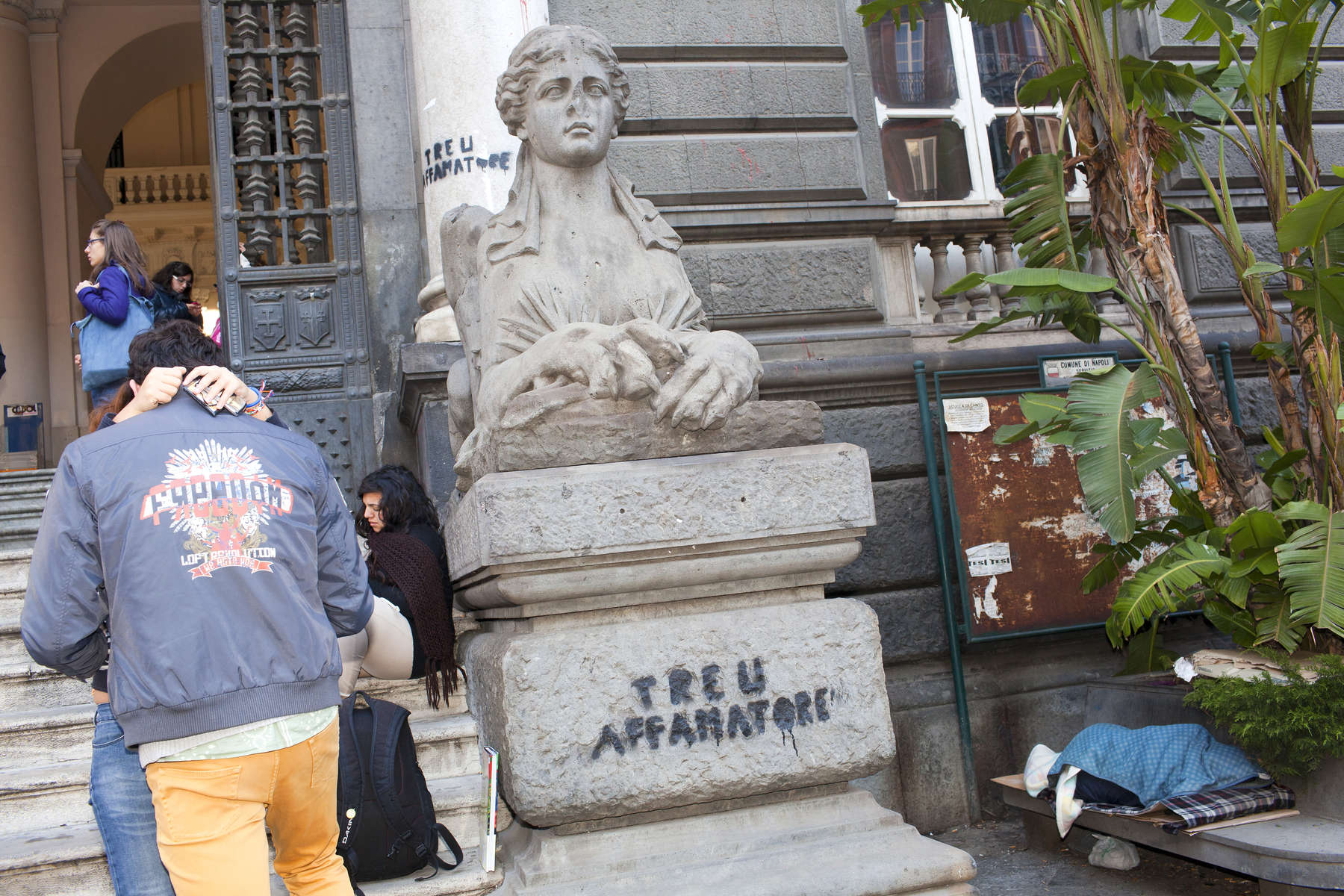 Students outside the Universita Degli Studi di Napoli {quote}Federico II{quote} on Corso Umberto I in the centre of Naples.Naples is a city on the west coast in Southern Italy and is the capital of the Campania region.+44(0)7711058090peter@peterdench.comPhotography ©Peter DenchCommissioned by:Dagmar Seeland, London OfficeHarald Menk, Hamburg Office