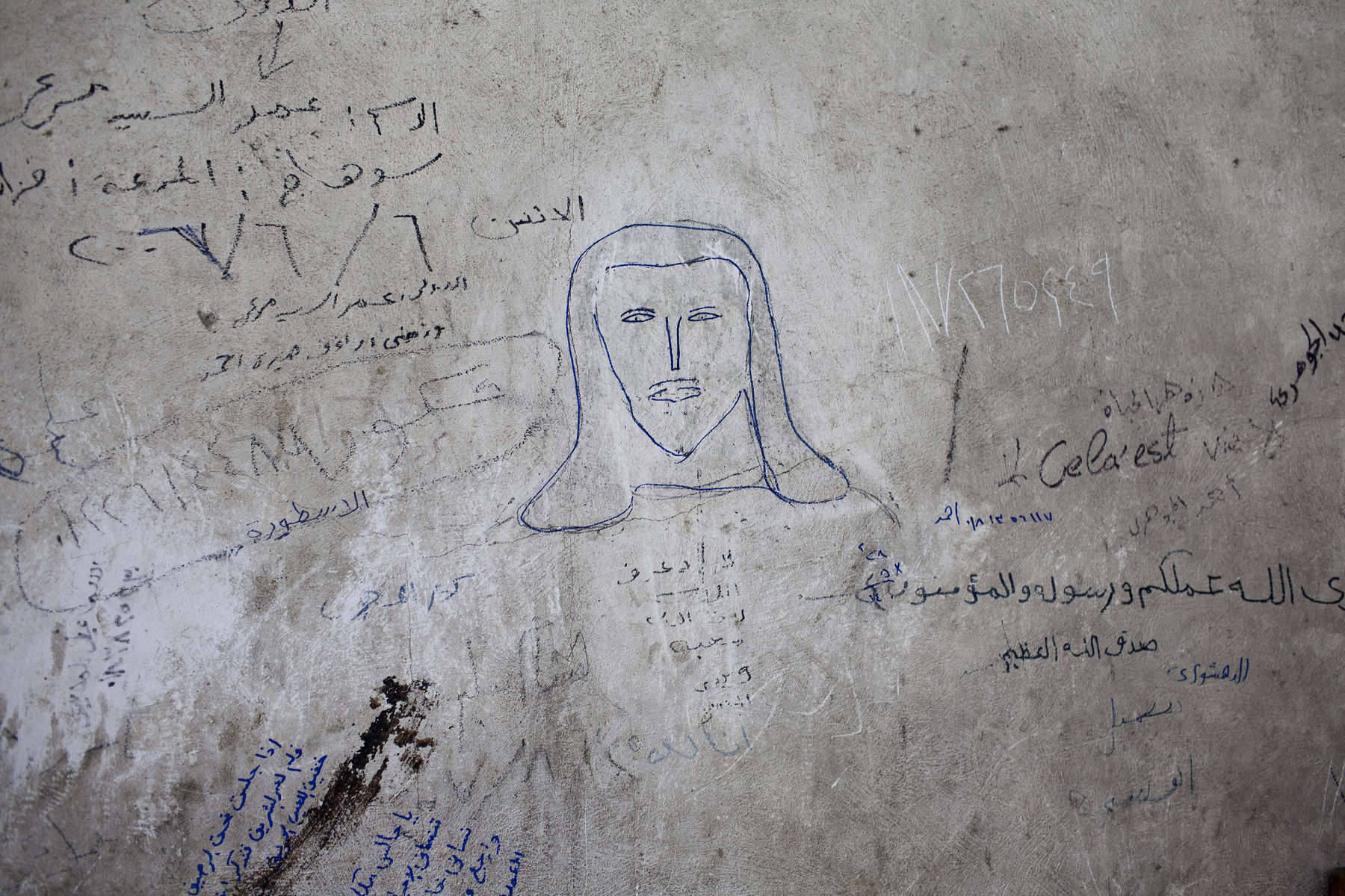 "A picture of Jesus Christ drawn on the wall of a home in Moqqatam.Moqqatam is a suburb on the edge of Cairo and home to a people known as the Zabaleen, said to be the world's greatest waste recyclers. The Zabaleen, which means plainly enough, ""the garbage collectors"", pick up around 4,000 tons of Cairo's waste each day. American researchers have shown that the Zabaleen recycle 85% of this garbage into something useful: a higher rate than anywhere else on the planet. The men do two shifts leaving about 4am and again around 9am. The rubbish is taken back to Moqqatam for the women to sit in and sort through. The organic waste is fed to livestock (the Zabaleen are originally swine herders), the rest sorted for recycling. The future of the Zabaleen is uncertain: if the Cairo authorities get their way, this community of around 25,000 Coptic Christians living in a Muslim country will be gone, and with it, their unique lifestyle."
