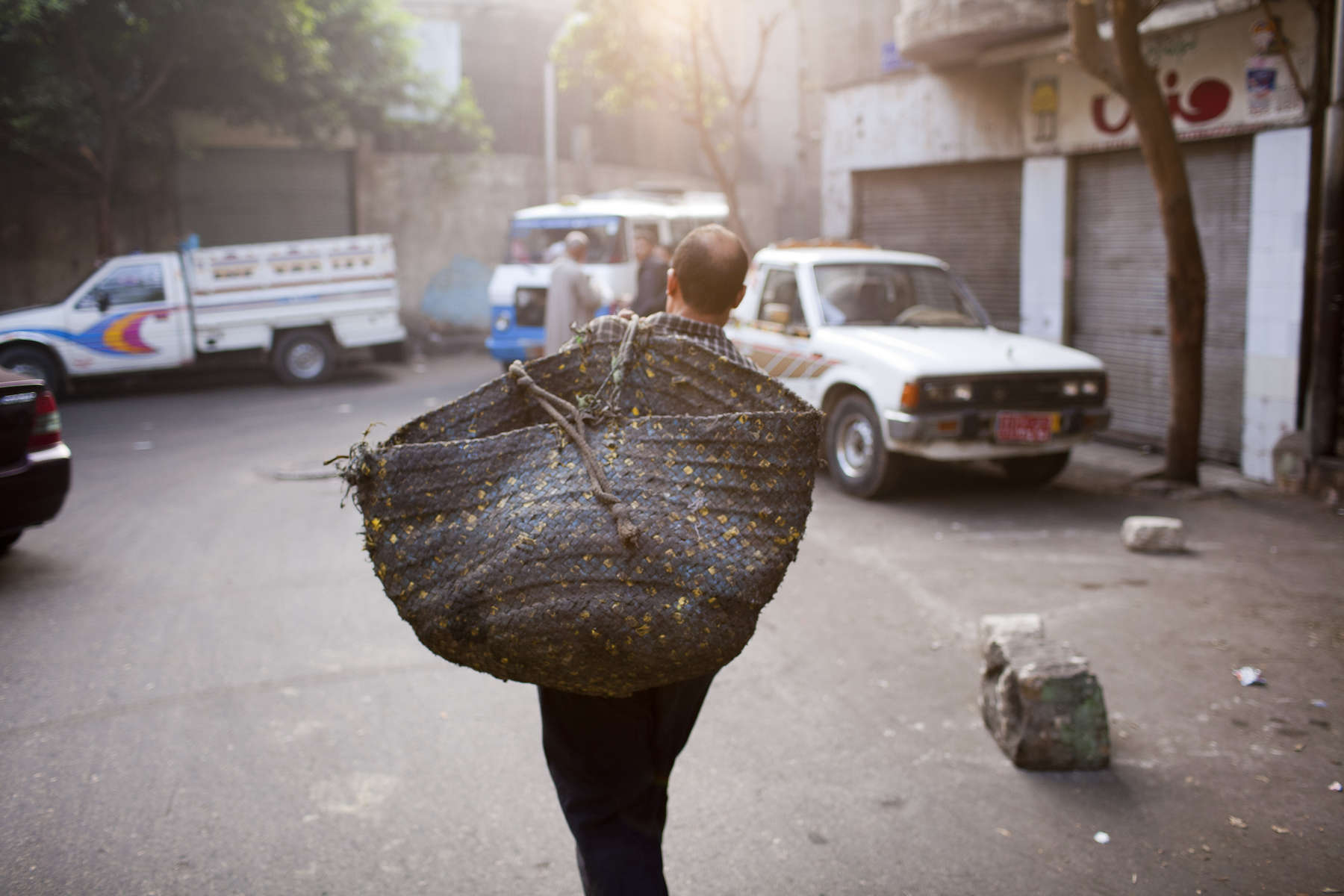 "A Zabaleen man collects garbage from a Cairo suburb before returnng from his shift to Moqqatam.Moqqatam is a suburb on the edge of Cairo and home to a people known as the Zabaleen, said to be the world's greatest waste recyclers. The Zabaleen, which means plainly enough, ""the garbage collectors"", pick up around 4,000 tons of Cairo's waste each day. American researchers have shown that the Zabaleen recycle 85% of this garbage into something useful: a higher rate than anywhere else on the planet. The men do two shifts leaving about 4am and again around 9am. The rubbish is taken back to Moqqatam for the women to sit in and sort through. The organic waste is fed to livestock (the Zabaleen are originally swine herders), the rest sorted for recycling. The future of the Zabaleen is uncertain: if the Cairo authorities get their way, this community of around 25,000 Coptic Christians living in a Muslim country will be gone, and with it, their unique lifestyle."
