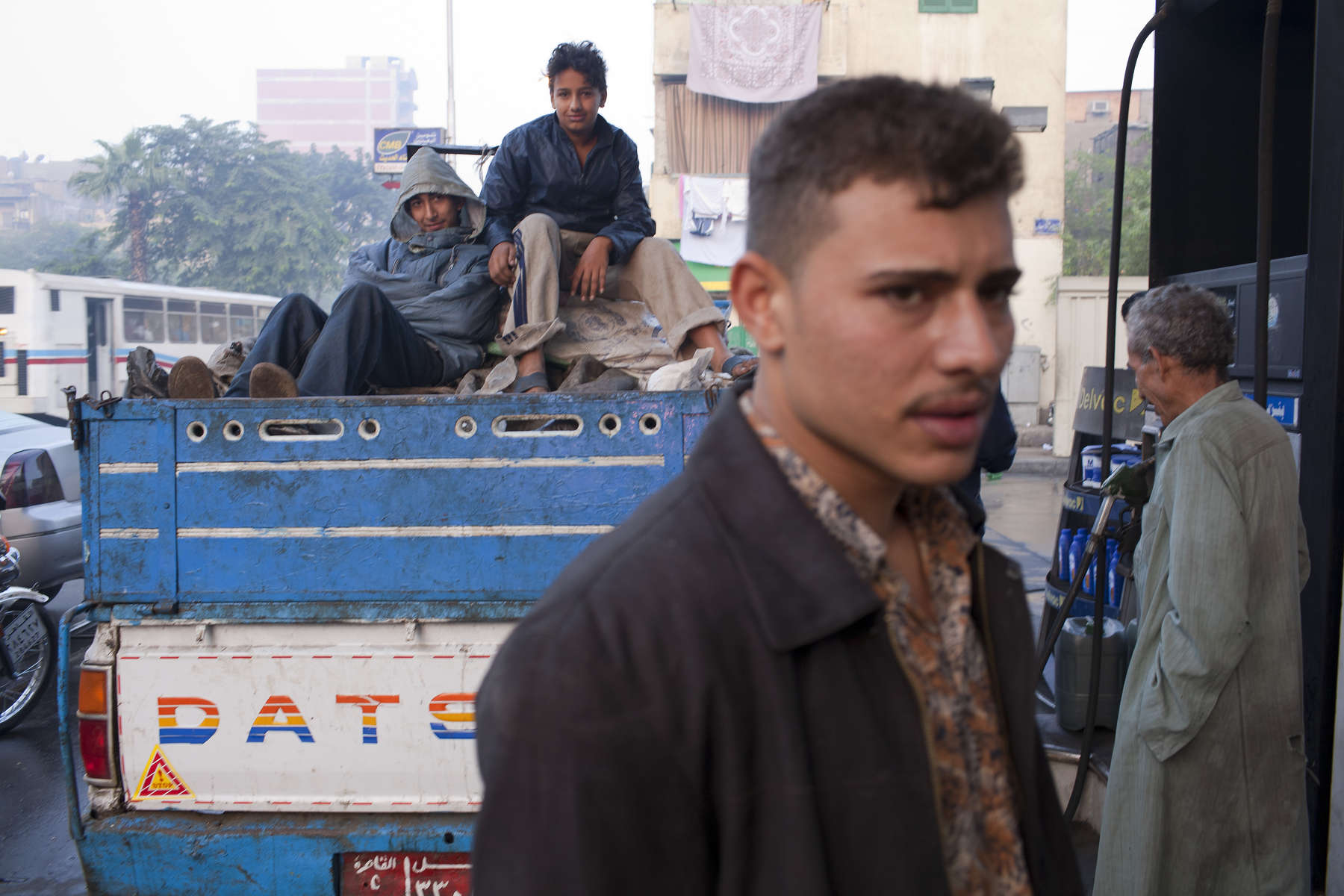 "A garbage collection crew of young Zabaleen men on the street in Cairo.Moqqatam is a suburb on the edge of Cairo and home to a people known as the Zabaleen, said to be the world's greatest waste recyclers. The Zabaleen, which means plainly enough, ""the garbage collectors"", pick up around 4,000 tons of Cairo's waste each day. American researchers have shown that the Zabaleen recycle 85% of this garbage into something useful: a higher rate than anywhere else on the planet. The men do two shifts leaving about 4am and again around 9am. The rubbish is taken back to Moqqatam for the women to sit in and sort through. The organic waste is fed to livestock (the Zabaleen are originally swine herders), the rest sorted for recycling. The future of the Zabaleen is uncertain: if the Cairo authorities get their way, this community of around 25,000 Coptic Christians living in a Muslim country will be gone, and with it, their unique lifestyle."