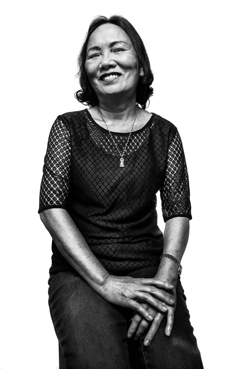 """My name is Tina. In Vietnamese, Nguyễn Thị Hà. I'm 62 years old. I came here in 2011. I miss Vietnam, but I like it here. I came because all of my sons and daughters live here. Because I'm with my family, I'm ok with leaving Vietnam. For a long time, in Vietnam, I was a nurse. I didn't work in a hospital, but in a clinic. I used to worry a lot because I took care of babies. I love children. I don't mind working in the nail shop because I stay busy.""Nguyễn Thị HàImmigrated to Baltimore from Quảng Ngãi, Vietnam in 2011Photo by Sean ScheidtInterview by Ashley Minner, 5/15/17Baltimore, Maryland"