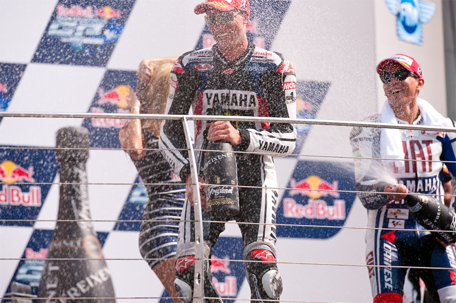 Red Bull Indianapolis Grand Prix Indianapolis Motor SpeedwayAugust 27-29 2010Podium CeremonyThird place finisher Jorge Lorenzo showers first-time podium appearance/second place finisher Ben Spies with champagne