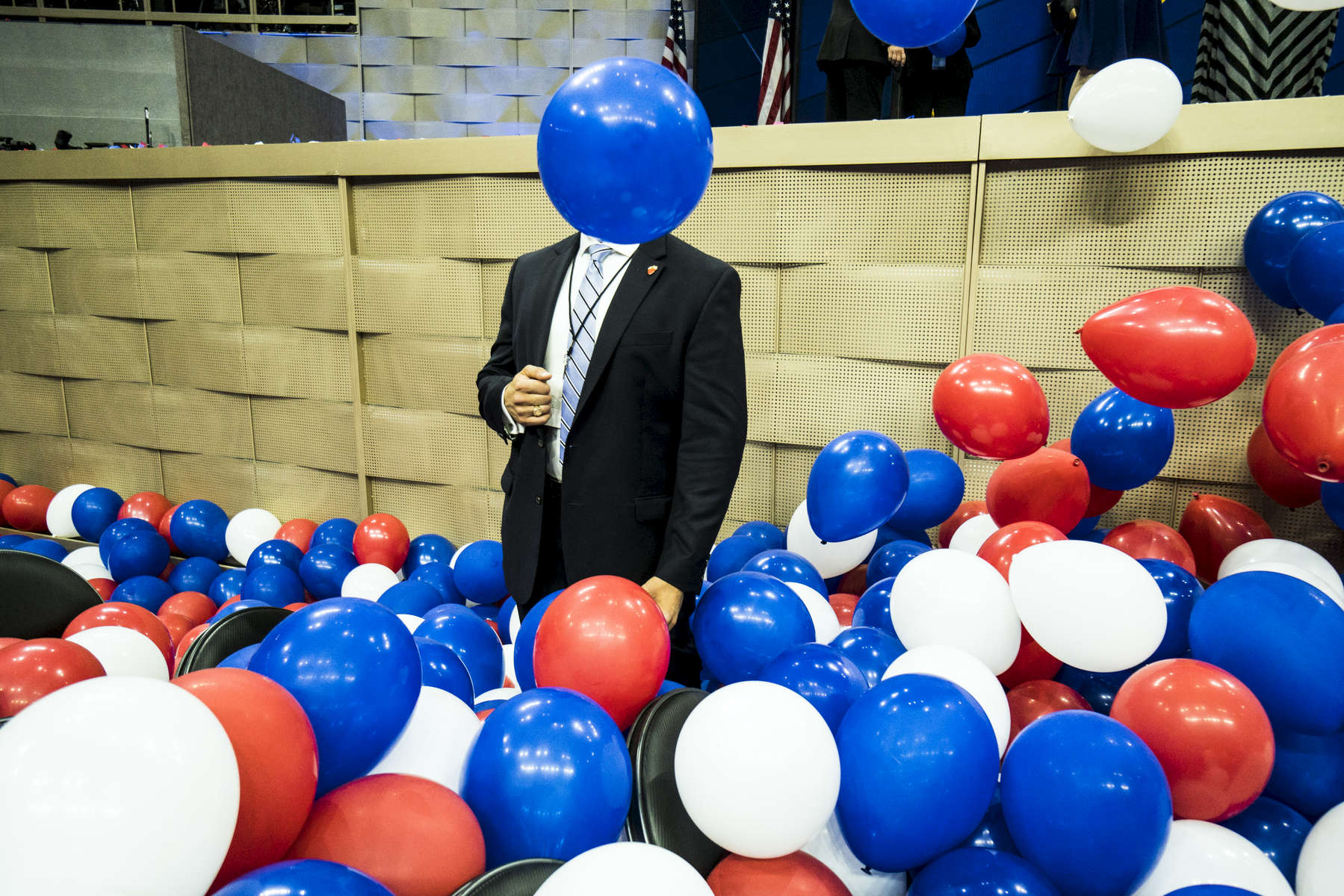 Philadelphia, PA - July 28, 2016: A Secret Service agent stands alert amid a plethora of patriotically colored balloons that were released following Hillary Clinton's keynote address as she accepted the democratic presidential nomination at the DNC on July 28, 2016.