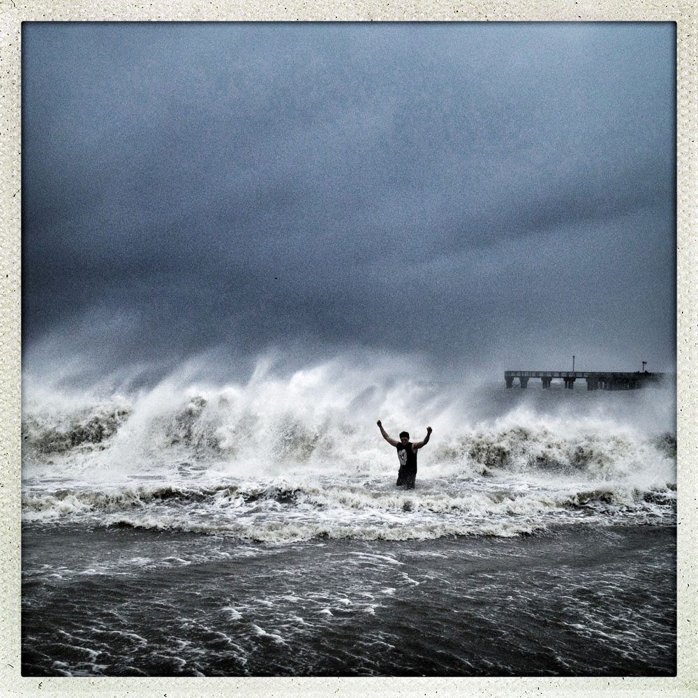 Coney Island, Brooklyn | October 29, 2012 Alberto Losano stands his ground in front of a massive wave.
