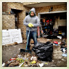 Staten Island, NY | November 2, 2012 Mughal Fahad takes a break from cleaning out all that remains of his worldly possessions from a first floor apartment that was completely flooded during the hurricane Sandy storm surge. Newly wed, Fahad and his wife are now staying with relatives in Brooklyn.