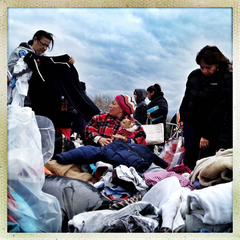 Staten Island, NY | November 2, 2012 Esther and her dog Pinky (center) look for clothes and food at an impromptu donation center set up by Staten Island residents and the Joseph Anthony Verdino Jr Field of Dreams Foundation. Many Staten Islanders feel their borough is being overlooked and ignored by authorities.