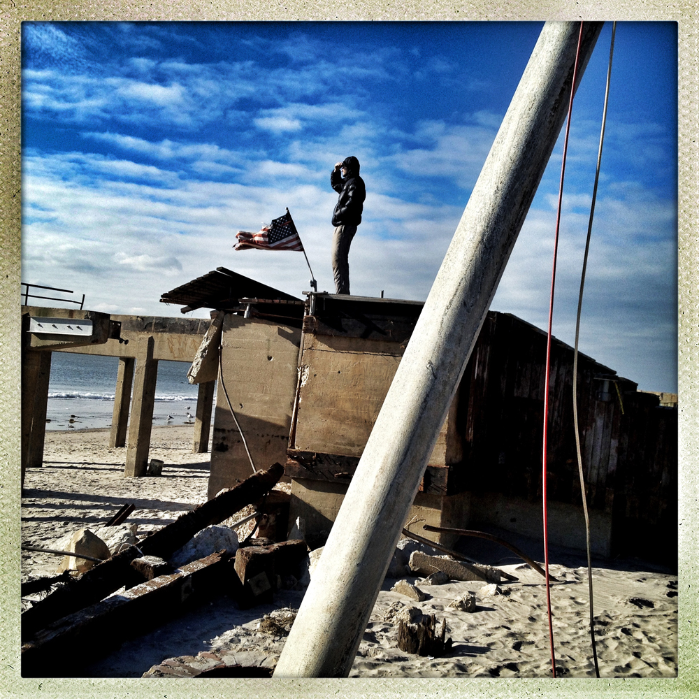 Pavel Ivanovo stands on the remains of the Rockaway Beach boardwalk, looking out into the sea. The recent immigrant voiced concern that echos across the region: {quote}Where is the help?{quote}