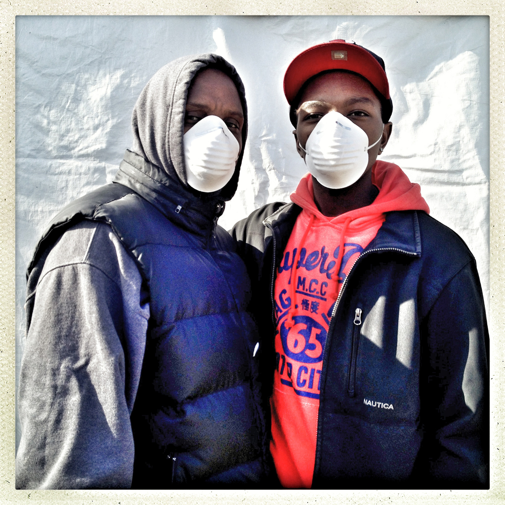 Robert Combs and his son, Robert Combs Jr., still in dust masks, take a break from mending their home to cast their ballots. This is the younger Combs' first time voting.