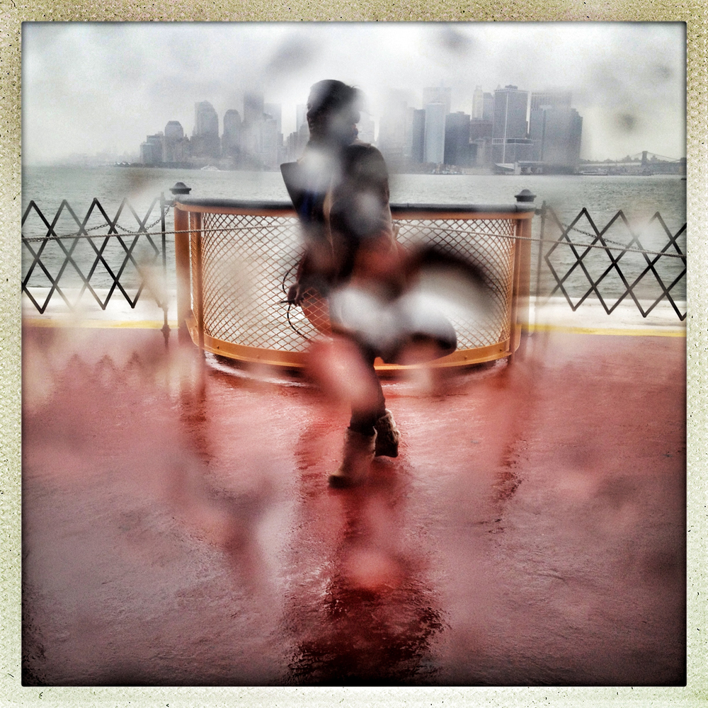 "Staten Island Ferry, NYC | November 7, 2012 A woman braves nor'easter winds and freezing rain as the Staten Island Ferry makes its way to Manhattan. Many zone ""A"" residents on Staten Island have been asked to evacuate their Sandy damaged properties once again as this new winter storm barrels down on New York."