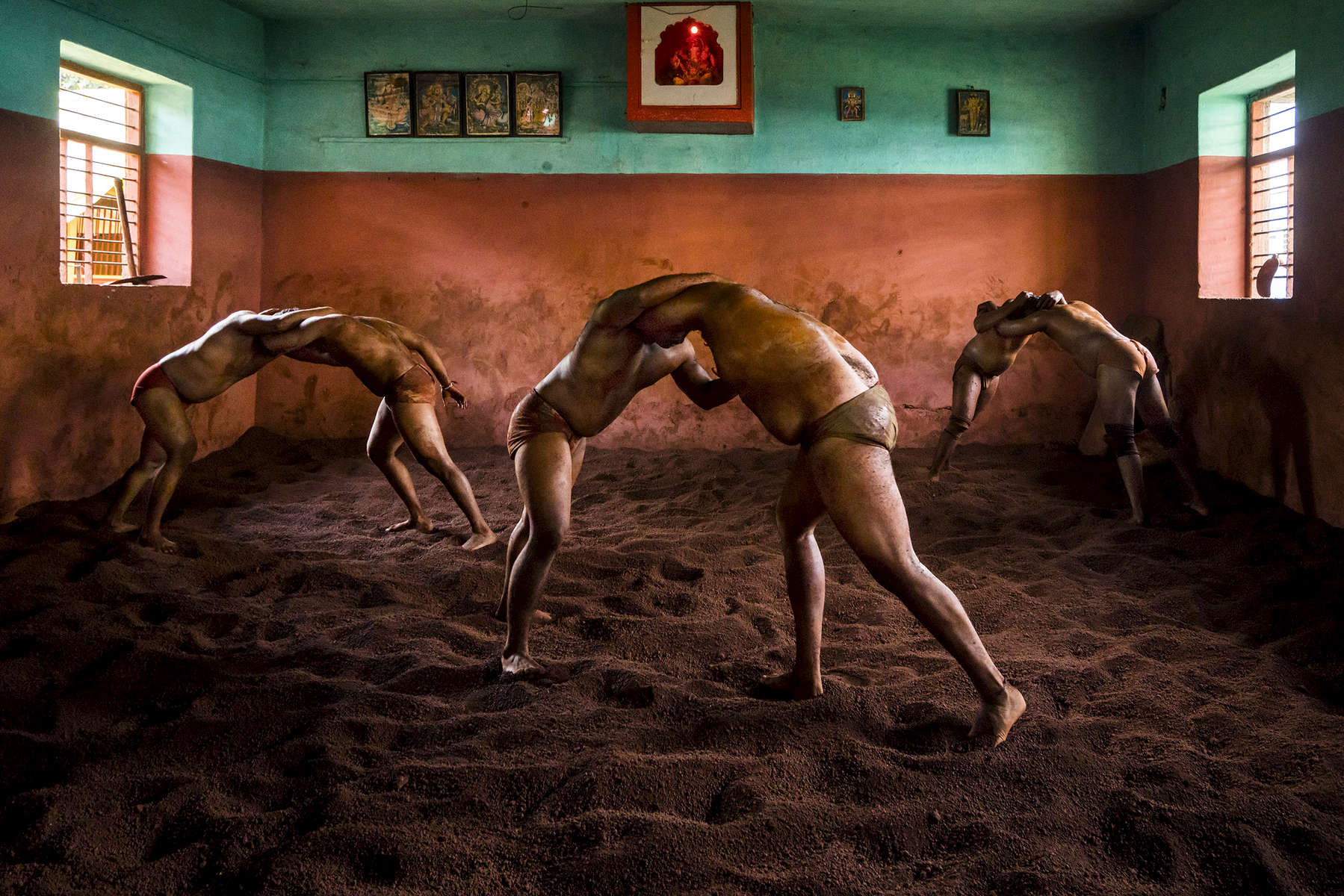 Kolhapur, India | October 8, 2015Indian Kushti wrestlers grapple during daily practice in a talim - a wrestling center - in Kolhapur, India. I spent time during my recent trip in India documenting this traditional sport as part of a larger body of work documenting traditional wrestling worldwide and conflict resolution through sports.