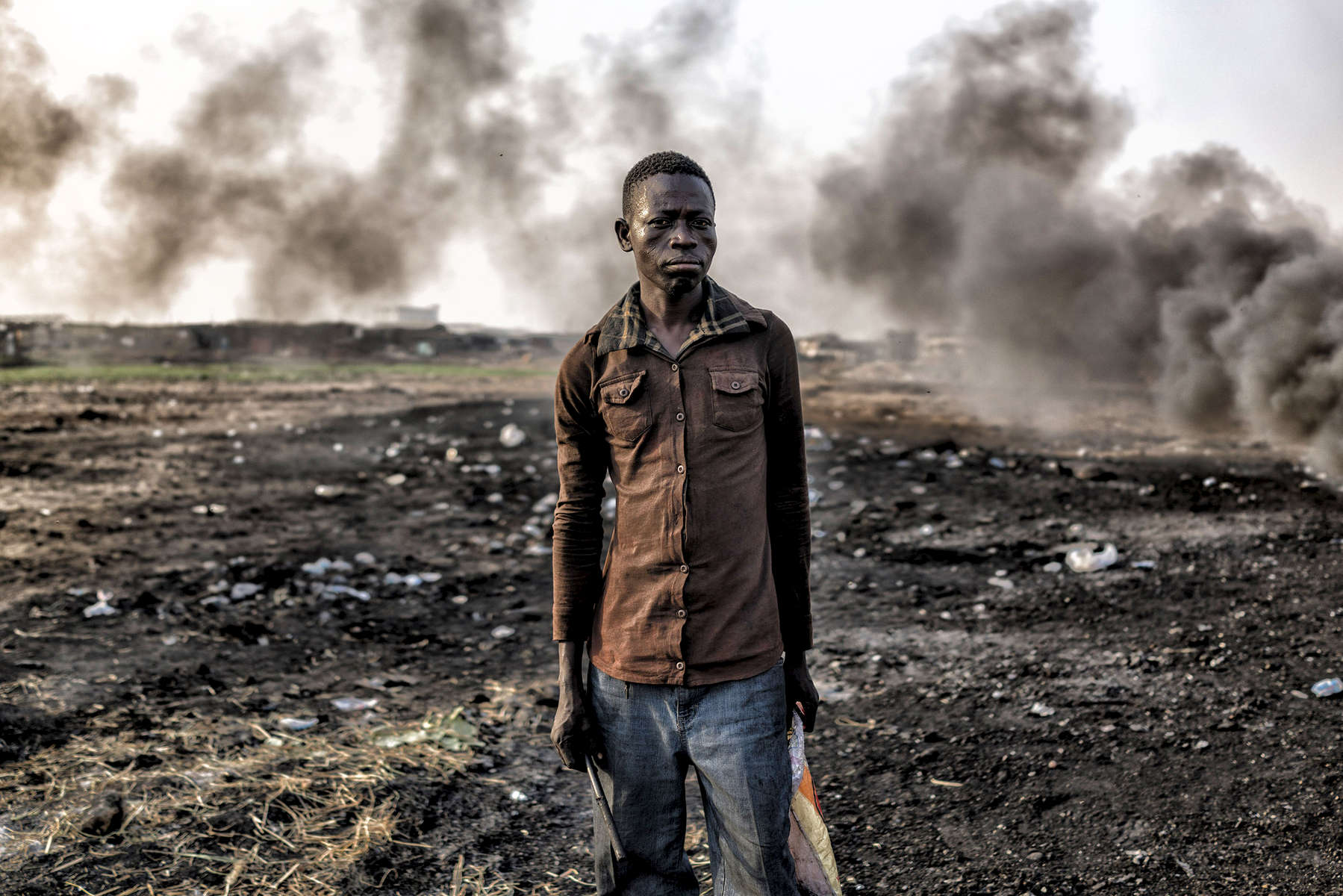 The Agbogbloshie dump's burning fields - where young men - almost all internal migrants from Ghana's northern Tamale region - toil in toxic smoke, burning down manufactured parts into their basic copper components hoping to make a slim income to feed themselves each day.