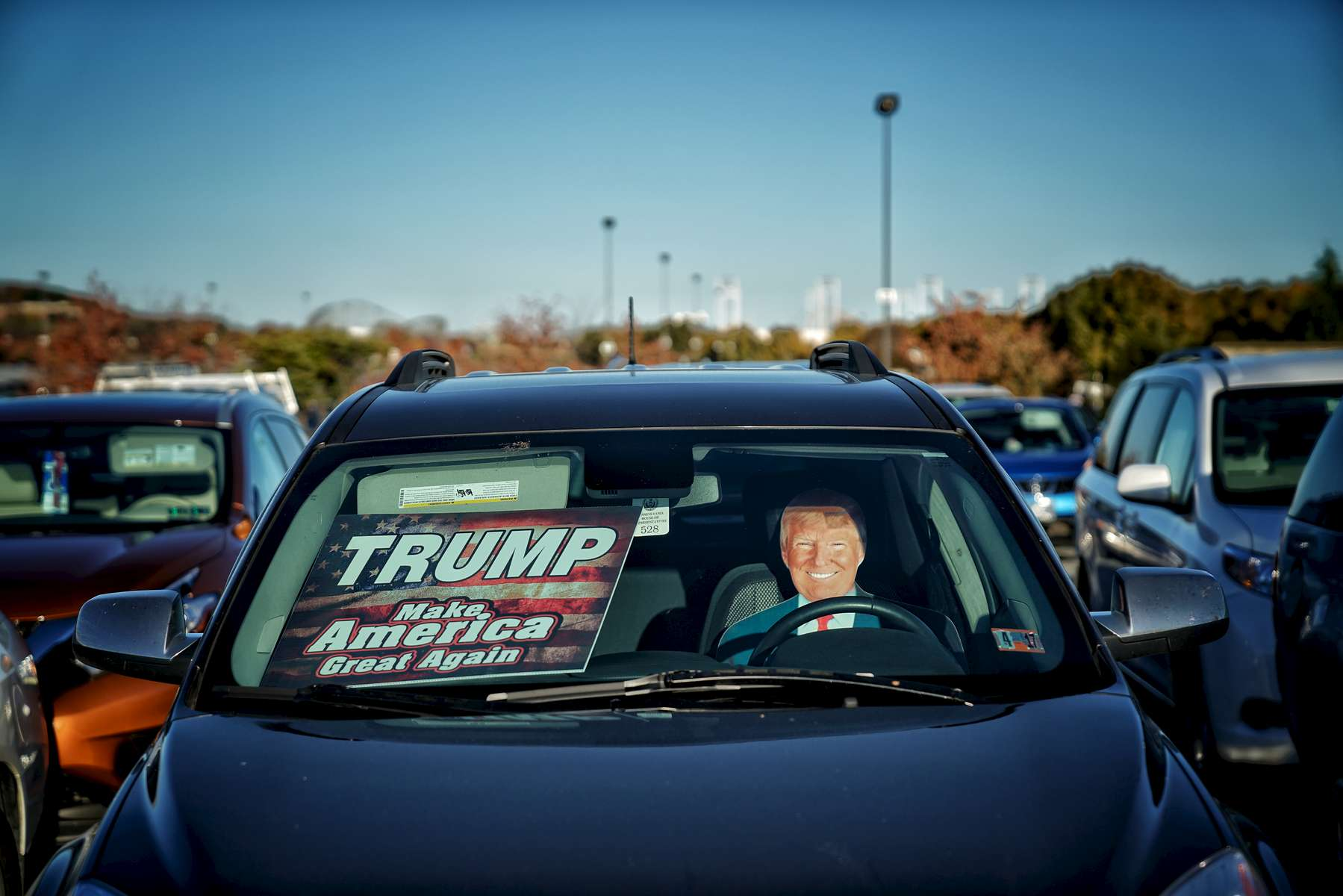 A car decorated with a Donald Trump sun visor is parked  at a campaign rally at the Giant Center November 4, 2016 in Hershey, Pennsylvania. With less than a week before Election Day in the United States, Trump and his opponent, Democratic presidential nominee Hillary Clinton, are campaigning in key battleground states that each must win to take the White House. (Photo by Ben Lowy for Time Magazine)