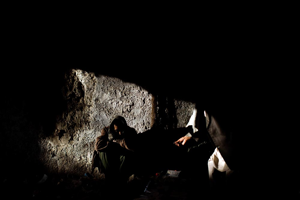 A drug deal in the Russian Cultural Center, an infamous heroin shooting gallery in Kabul.