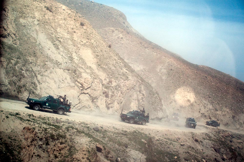 A large convoy of Afghan military and police, including the provincial governor, drove for hours along dusty, unpaved tracks to reach an isolated poppy-producing region of Nangarhar province in Afghanistan.
