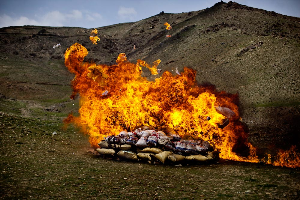 The Afghan government burns 6.5 tons -- a miniscule portion of the nation's drug production -- of opium, heroin, and hashish on the outskirts of Kabul.