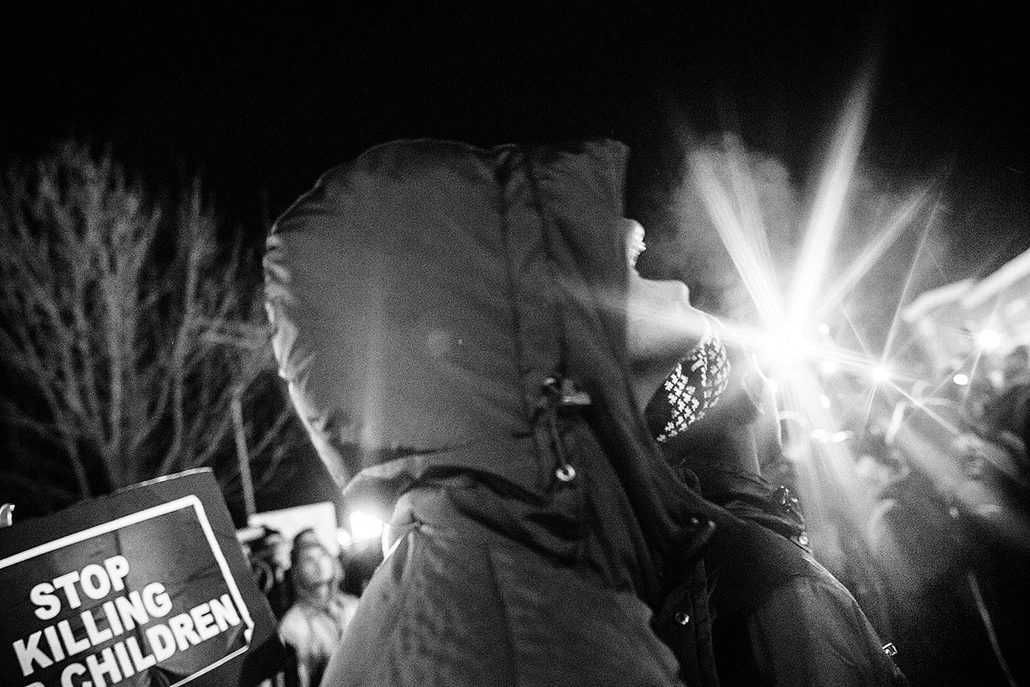 FERGUSON, MO - NOVEMBER 25: A protester screams at the police and National Guard formations protecting the Ferguson police department a night after the riots and destruction that followed the announcement of the grand jury's decision not to indict white police officer Darren Wilson in the death of unarmed black teen Michael Brown. (Photo by Benjamin Lowy/Reportage by Getty Images)