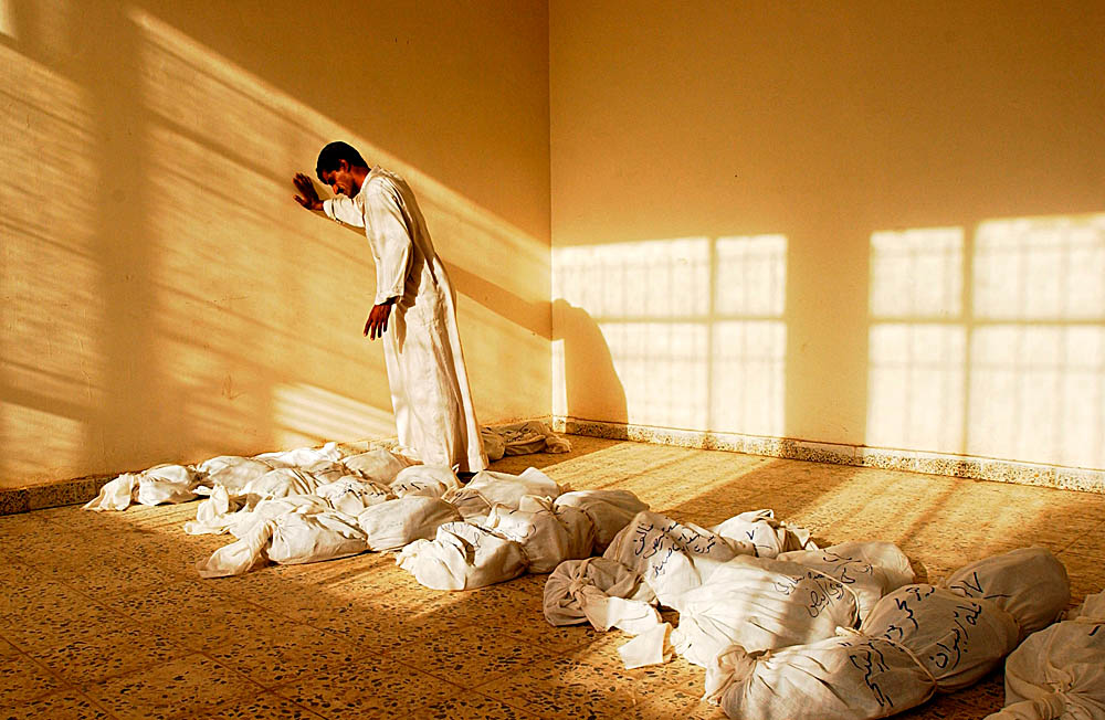 Family members of Iraqis missing since the 1991 Shia uprising gather in a small gymnasium to identify and bury the bodies of their relatives. The bodies were uncovered in mass graves around every major southern cityfollowing the fall of Saddam Hussein's government.