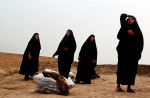A group of women cry as the mass graves of thousands of Iraqi Shias executed after the 1991 uprising against Saddam Hussein are uncovered. Thousands of decomposed bodies, many of them soldiers, were exhumed to be claimed by despondent family members.