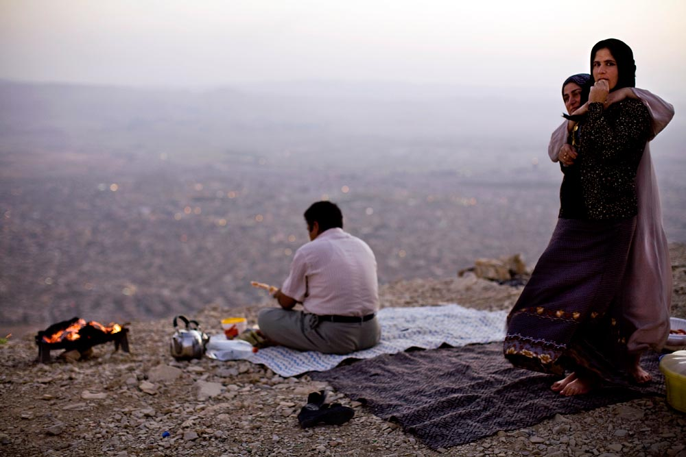 A Kurdish family gather atop a cliff for a Friday evening picnic.
