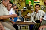 Men converse in a intellectual's teahouse in Sulaimaniya