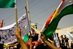 Kurds protest during a political march against a proposed Iraqi government power sharing law.
