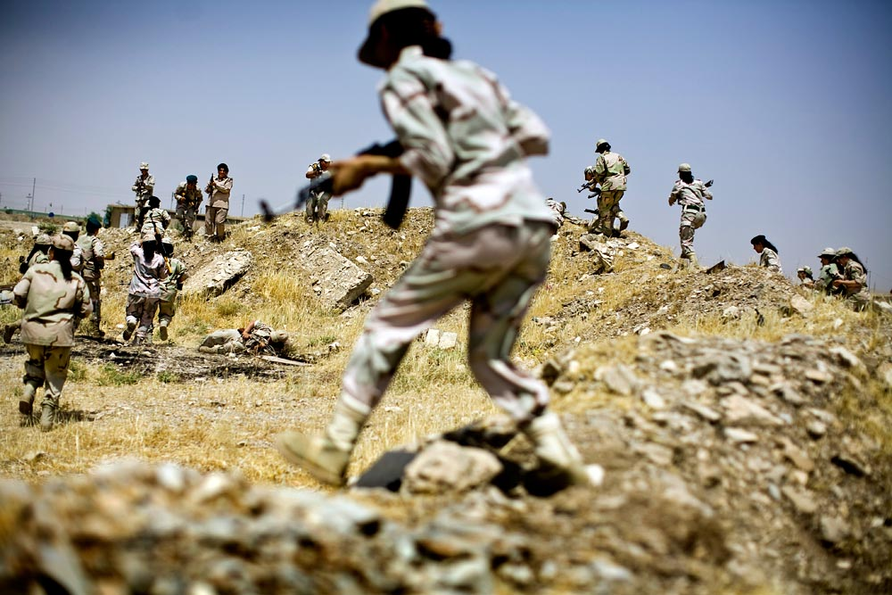 Female Kurdish Peshmerga fighters practice their formations and attack maneuvers at the Maskar Salam Base near Sulimaniya in Kurdistan, Iraq.