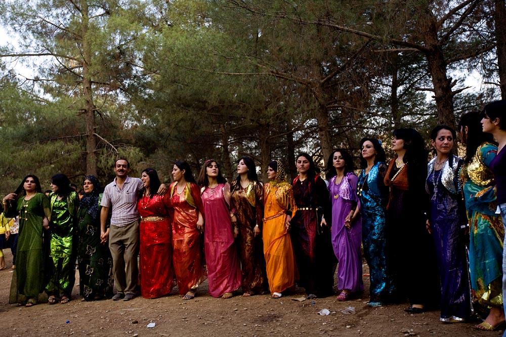 People celebrate at a wedding in Kurdistan, Iraq.