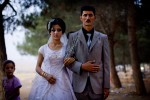 A newly married Kurdish couple pose for a photograph.